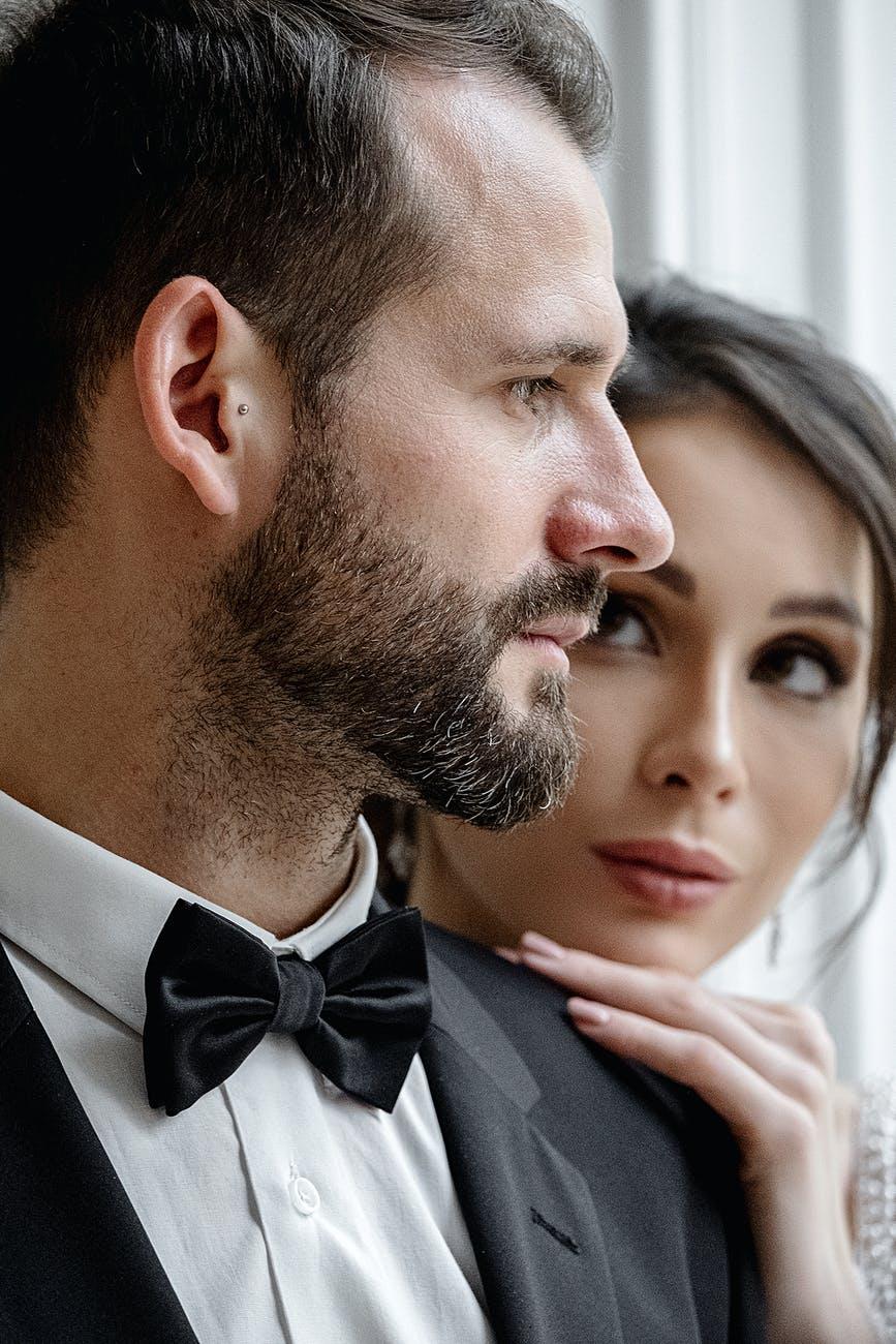 crop young newlyweds bonding in light wedding studio
